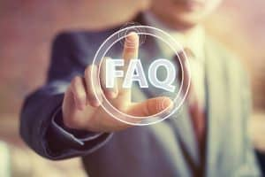 business man pointing to frequently asked questions